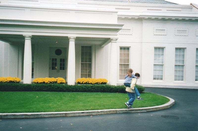 Emma at white house outside035